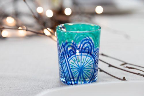 Green and blue tea light